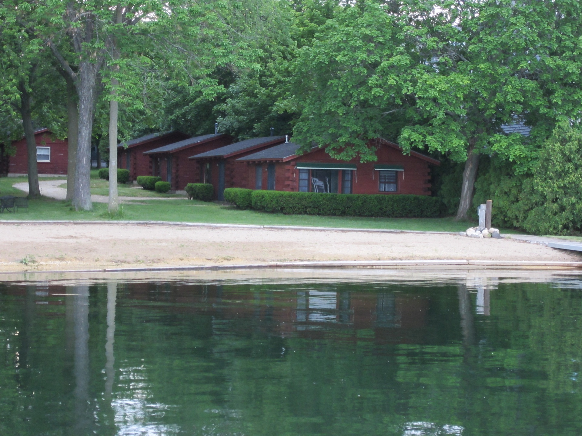 Cabins with reflection on calm evening